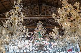 various great murano glass chandeliers at the bisanzio glass gallery in venice italy