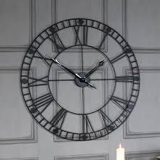 large black iron skeleton wall clock