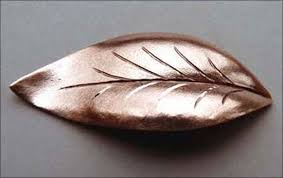 metal punch shapes. first decide on the leaf shape, draw it onto metal and pierce out basic using a straight line punch lead block, tap in central shapes