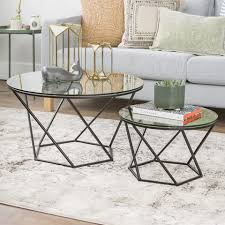 This sturdy mdf and laminate piece comes with two versatile wicker baskets in the bottom, which work well for books, remote controls and other small items. Coffee Tables Walker Edison