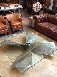 very cool coffee table huge propeller as a coffee table base with a glass top a interior design