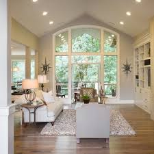 lighting in vaulted ceilings. window shape for vaulted ceiling like the lighting too and floor in ceilings