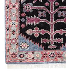 pink and black antique persian rug