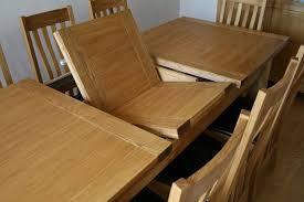 the classic erfly extending table mechanism on the tallinn table