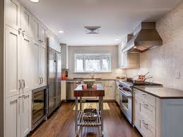 Inspiration for a contemporary u-shaped enclosed kitchen remodel in Denver  with stainless steel appliances