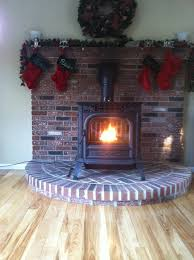 harman v anniversary pellet stove fired up on a traditional brick hearth