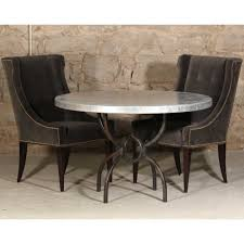 image of logan iron dining table with 48 round hammered zinc top in zinc top