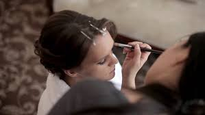 wedding makeup artist making a make up for bride beautiful y model indoors beauty woman with curly hair female portrait