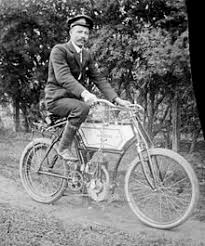 a man on a minerva motorized bicycle in australia not long after the start of the 20th century photo by alice manfield a small internal bustion engine