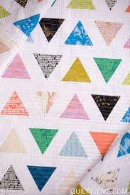 Introducing the TRIANGLE POP quilt pattern - Quilty Love & I finished off my Triangle Pop quilt with 3/4in straight lines using my  walking foot. I like how it kept with the modern feel of this quilt. Adamdwight.com