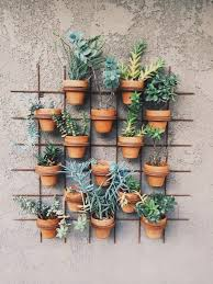 Outdoor Wall Decor ideas with wood , plants and lights. Vertical PlanterVertical  GardensVertical ...