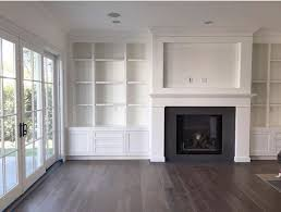 Amber Interiors - built in shelving around fireplace, cut out for TV - www.