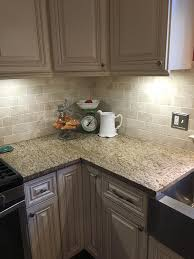 Granite With Cream Cabinets My New Kitchen Typhoon Bordeaux Granite With Travertine Tile