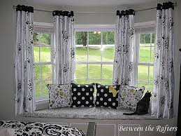 hanging curtains on a bay window lovely between the rafters do it yourself bay window curtain rod