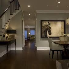 elegant dark wood floor and brown floor dining room photo in chicago with gray walls