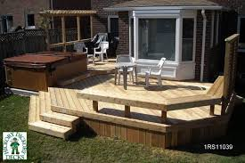 large 2 level deck with 2 large seating areas a spa and