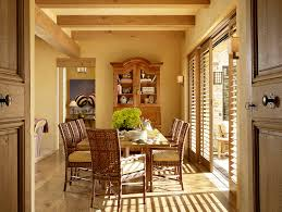 black plantation shutters dining room terranean with woven dining chairs wood
