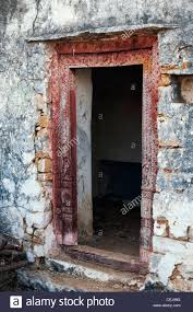 old ancient indian carved door frame into a derelict house in the india countryside andhra