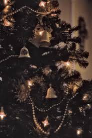 a traditionally decorated christmas tree with beads and ceramic hanging bells on33