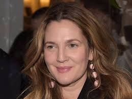 drew barrymore demonstrates an almost no makeup beauty look at an event jason kempin getty images