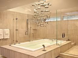 lighting bathrooms modern chandelier above the bathtub on bathroom bathroom modern lighting
