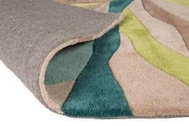 infinite splinter rug in teal and green