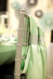 mint green chair covers with rhinestone accents