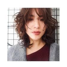 ウェーブミディアムウルフ Assort Tokyoアソートトウキョウのヘア