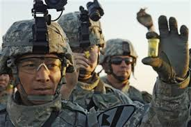 Pfc. Douglas Wojtowicz and fellow soldiers show their combat ear ...