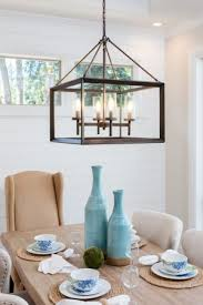 dining room table and pendant light fixture in new luxury home is set with joanna gaines farmhouse lighting n87 farmhouse
