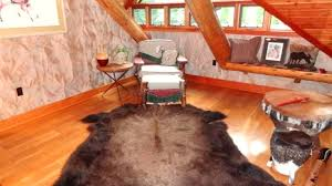 animal skin rug in log home rugs faux canada cowhide faux animal hide rugs