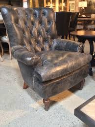 bronco chair is crafted of grey weathered leather with nailhead trim this classic chair will