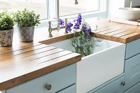 a white ceramic belfast sink with solid oak worktops