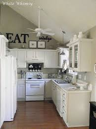 high ceiling kitchen decorating ideas. love the above cabinets, and thick plank on top of cabinetsinstead high ceiling kitchen decorating ideas e