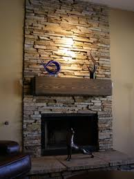 Stone Fireplace Fronts dark lighting stone fireplaces designs with wood  mantel around
