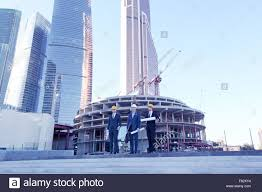 architecture blueprints skyscraper. Architects With Blueprint At Skyscrapers Background - Stock Image Architecture Blueprints Skyscraper