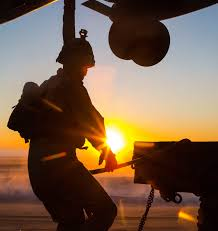 Marines with the 26th MEU perform lift at sunset on the beach