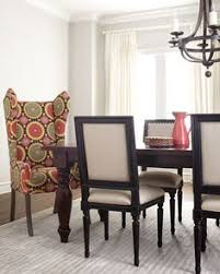 preslie dining table upholstered seating at horchow gotta have 2 of these chairs at the head of my table go beautiful with my yellow high ceiling