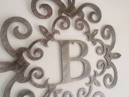 family initial monogram inside a metal scroll with b letter 30 inches wall decor