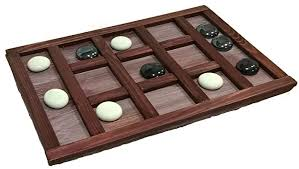 Game With Stones And Wooden Board