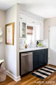 white upper cabinets and navy lower cabinets with black and white rh decorpad com blue kitchen rugs fl rugs kitchen