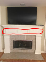 ideal height for tv over fireplace ideas