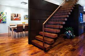 a house with zip large trendy wooden floating staircase photo in austin artistic wood pieces design