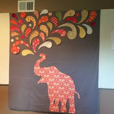 Paisley Splash Elephant Quilt – Rileys Quilts & The pattern is a free download from windham fabrics, but the final size of  it is something like 22×33 so I had to get out some drawing paper and draw  my own ... Adamdwight.com