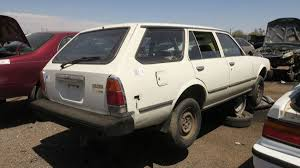 1981 Toyota Corona in the junkyard, with photos