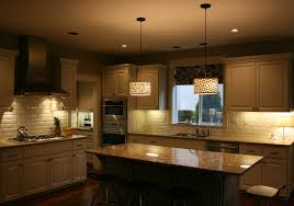 unique kitchen lighting fixtures. Two Classic And Sophisticated Drum Pendant Lighting Fixtures Over An Granite Top Island In Antique White Kitchen Unique O
