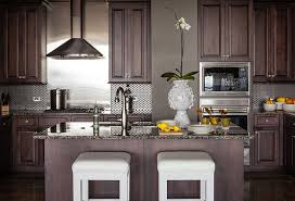 gorgeous kitchen with chocolate cabinets paired with granite countertops and stainless steel backsplash