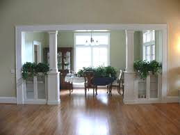 formal dining rooms with columns. seperating a living room and dining | built-in bookcases columns create formal rooms with