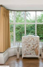 Short curtains will be needed if the bay window has an extra wide window  sill.