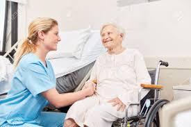 Geriatric Nursing Nurse Or Geriatric Nurse Looks After Senior Woman In Wheelchair